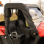 Kymco UXV500 Full Cab Enclosure - passenger door rolled and stored for traveling